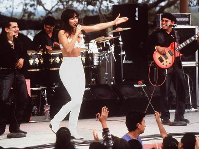 "Actress Jennifer Lopez, who plays Selena in the movie ""Selena,"" performs with her band in one of the scenes from the movie. (RICCO TORRES/AFP/Getty Images)"